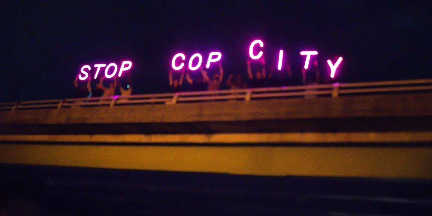 Stop Cop City light brigade demonstration